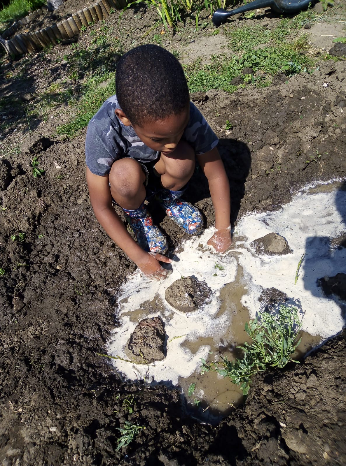 Using his imagination to make a pond
