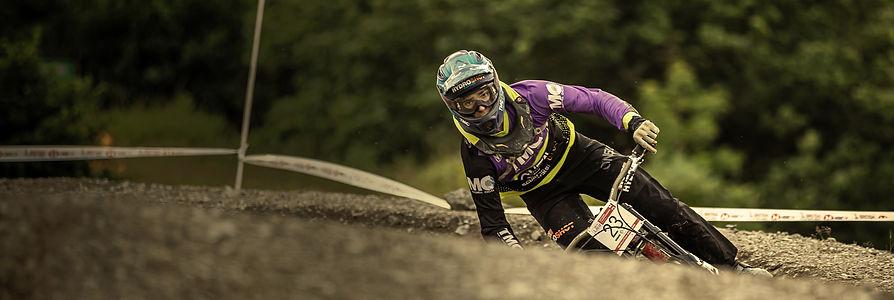 Downhill mountain biking | Orange Formula One car | KMC Sponsorship & Marketing Consultancy | England