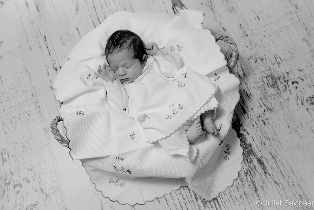 Baby in embroidered outfit