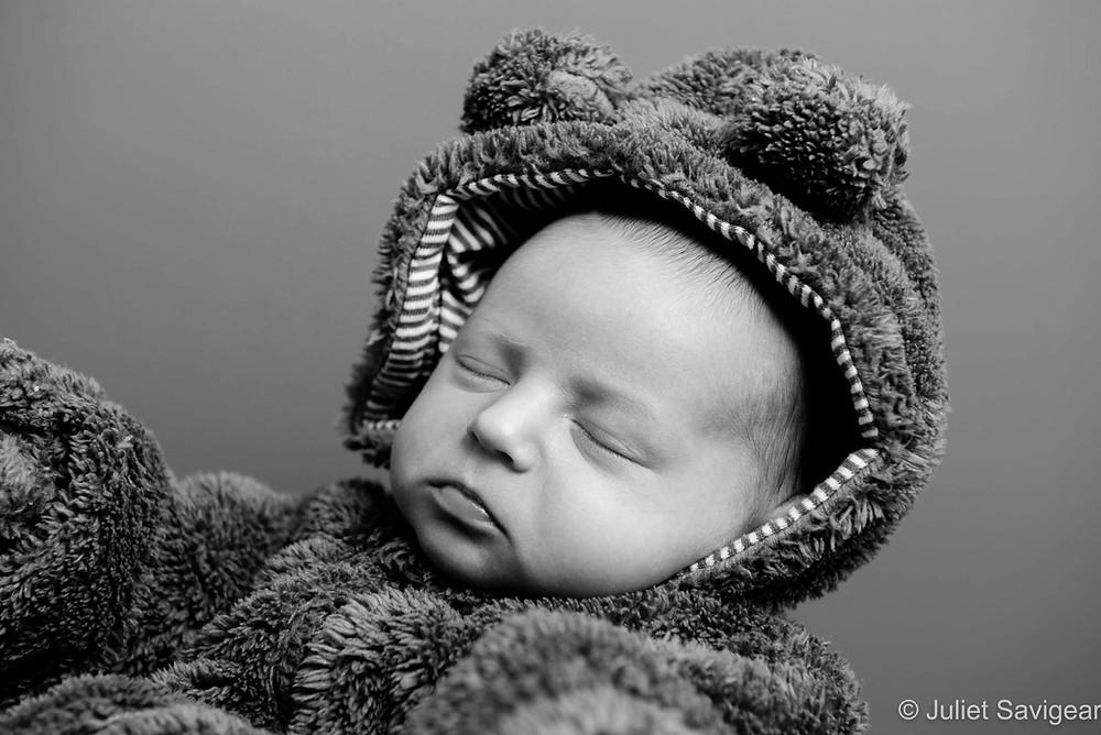 Newborn baby in bear suit