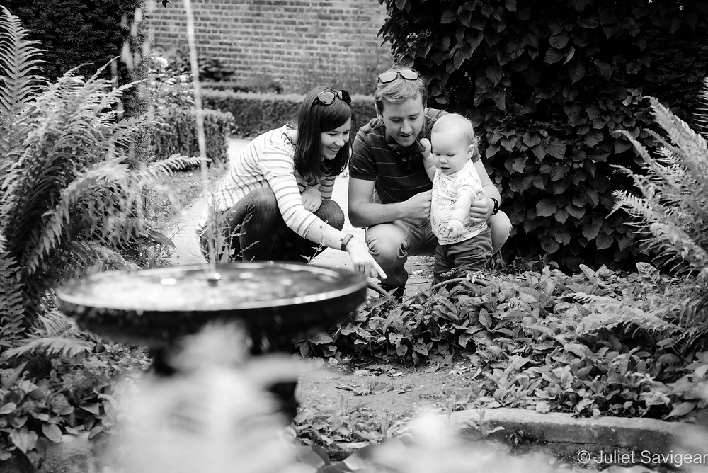 Toddler & Family By Pond