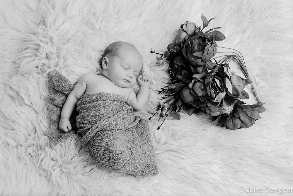 Sleeping baby girl with flowers