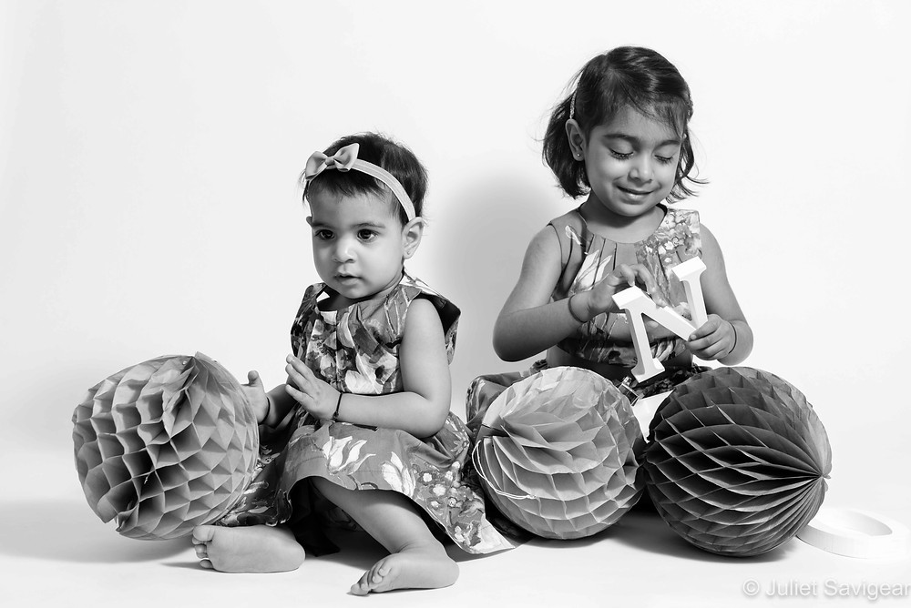 Sisters and birthday pom poms