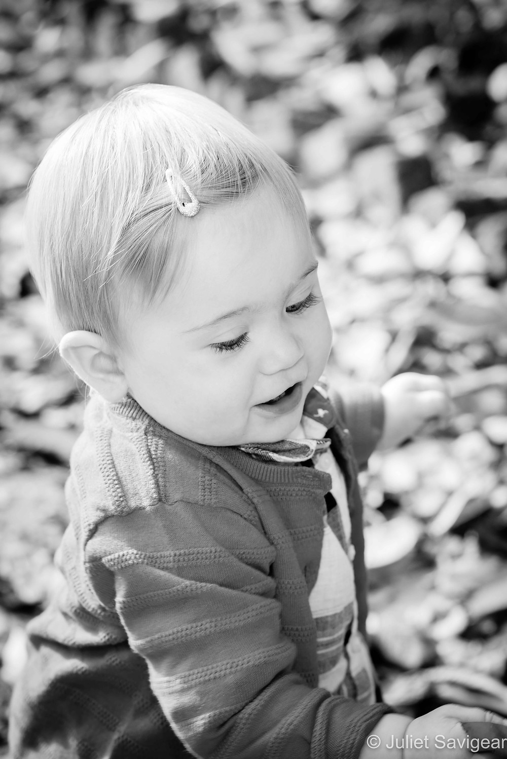 Toddler and leaves