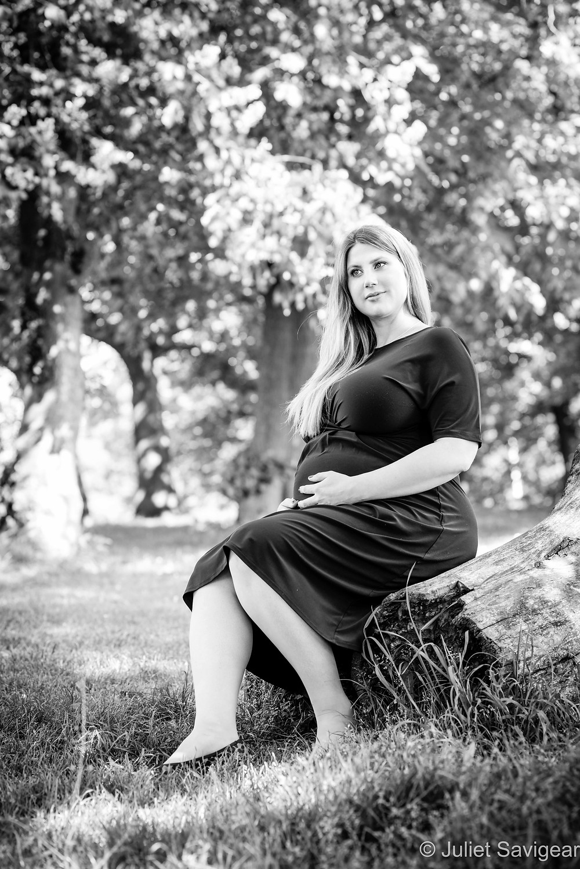 Pregnant lady sat on log