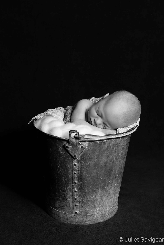 Newborn baby in bucket