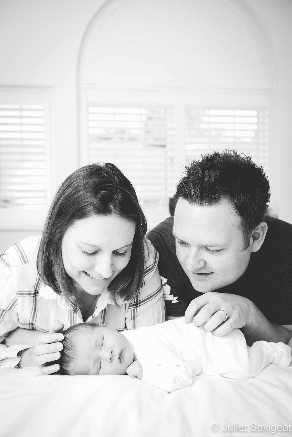 Family photo at home with newborn baby