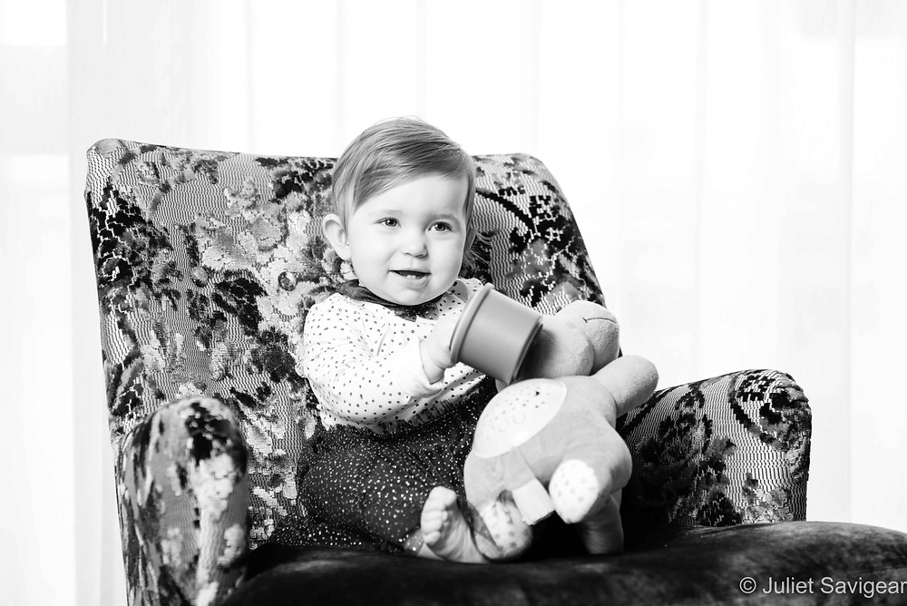 One year old girl on armchair