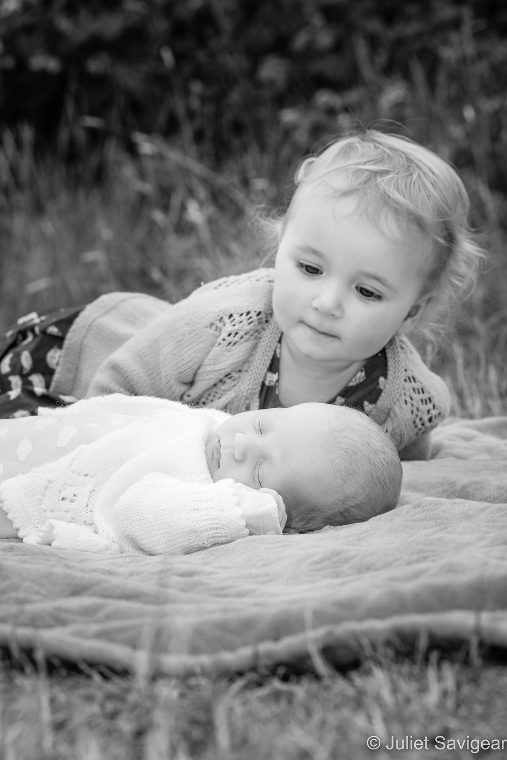 Toddler with newborn baby