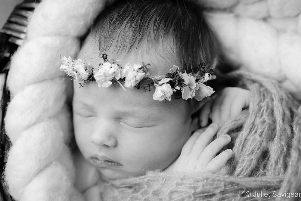 Newborn baby girl with rosebud headband