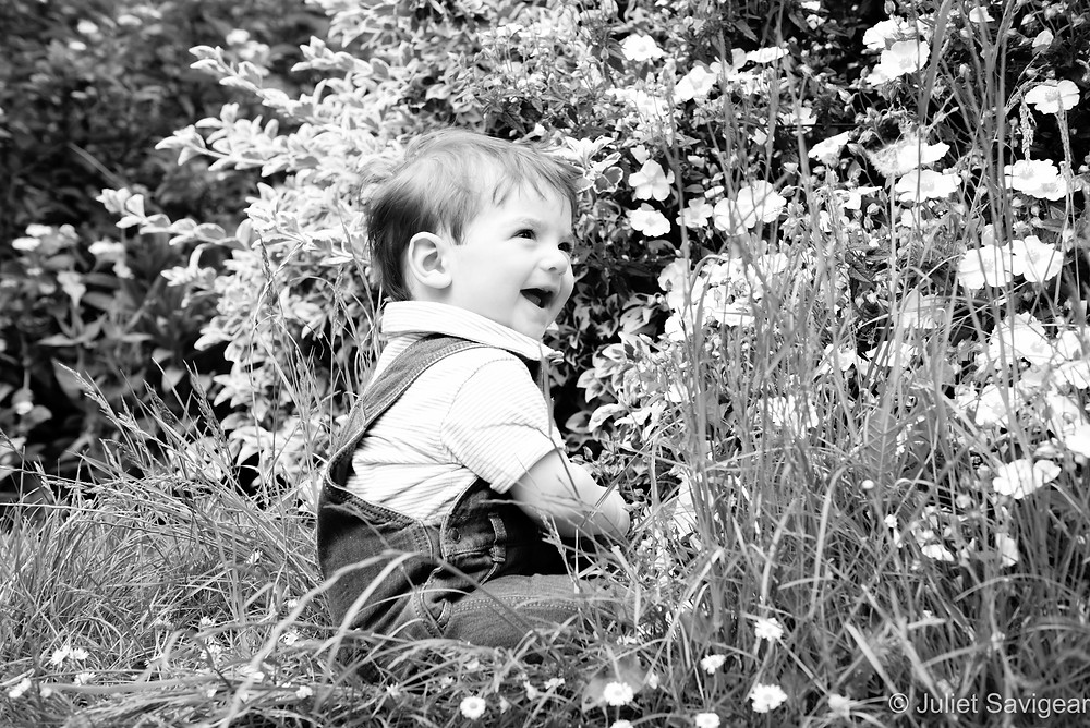 Baby among the flowers