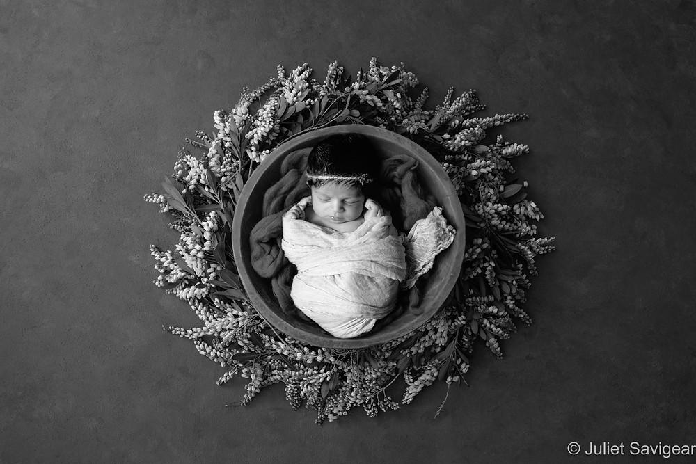 Newborn baby in floral wreath