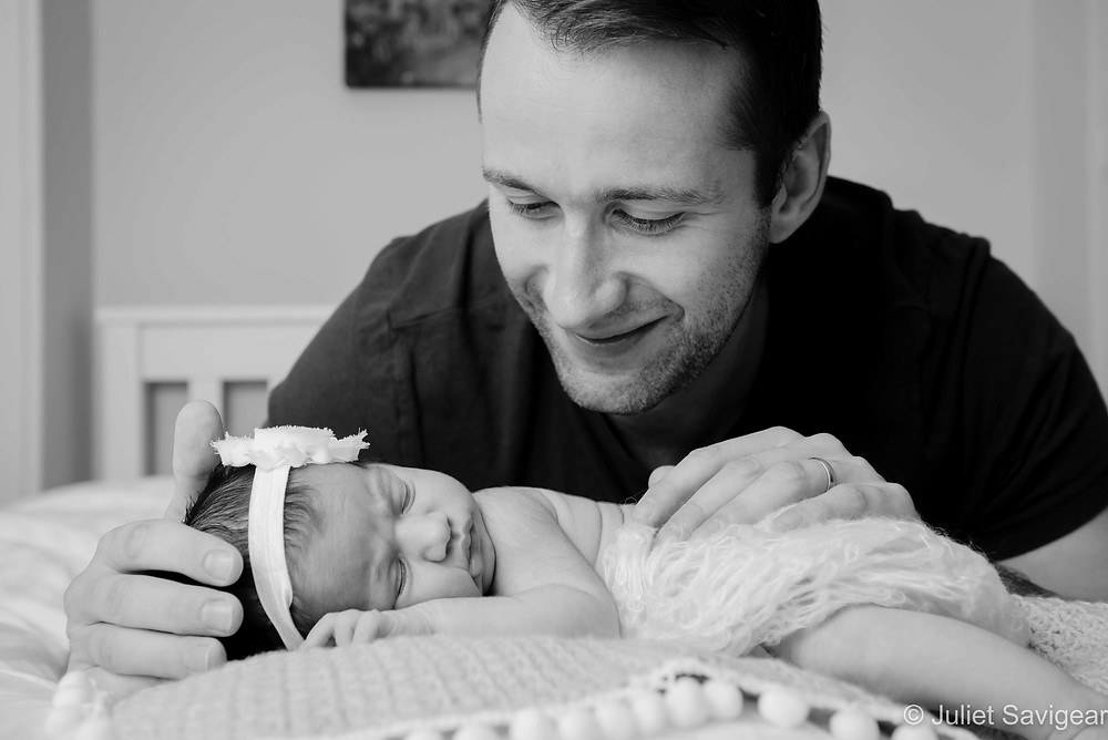 Proud daddy with newborn baby girl