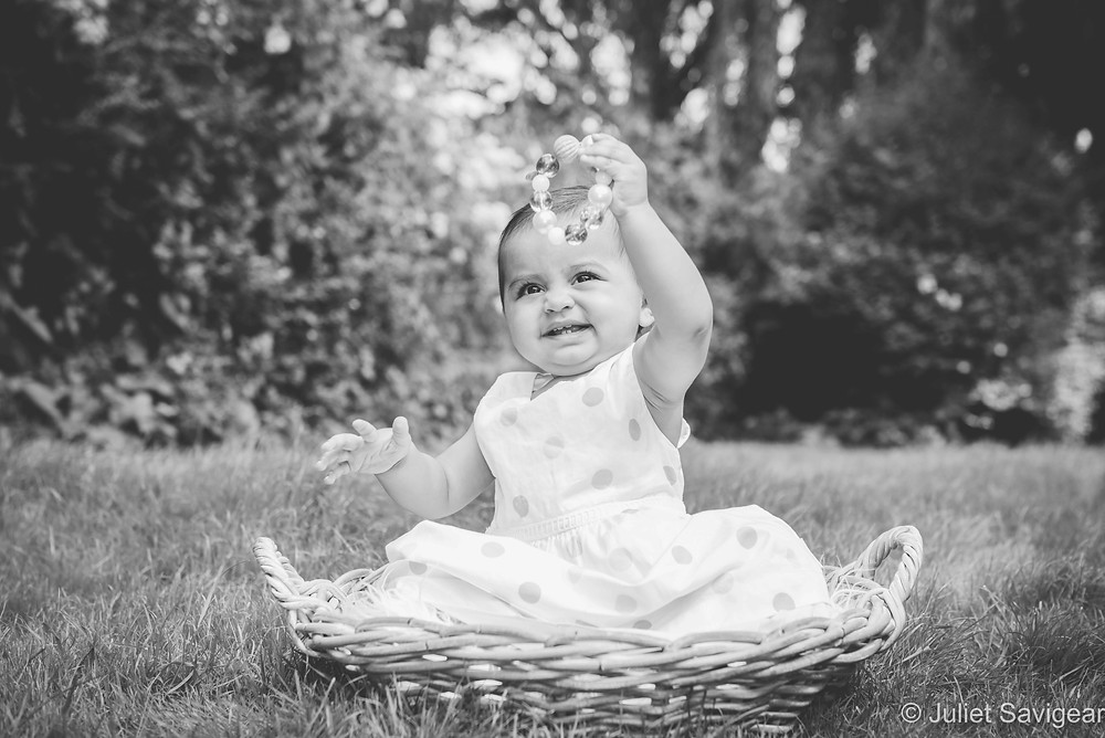 Baby girl in basket with beads
