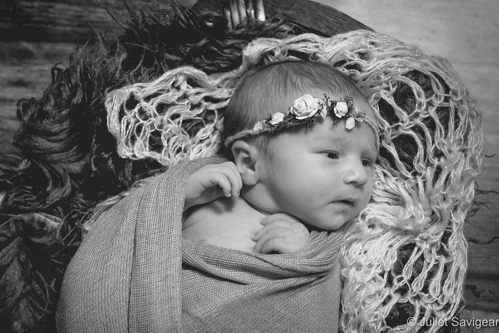 Newborn baby with flower headband