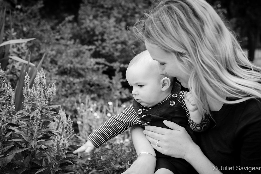 Baby looking at the flowers