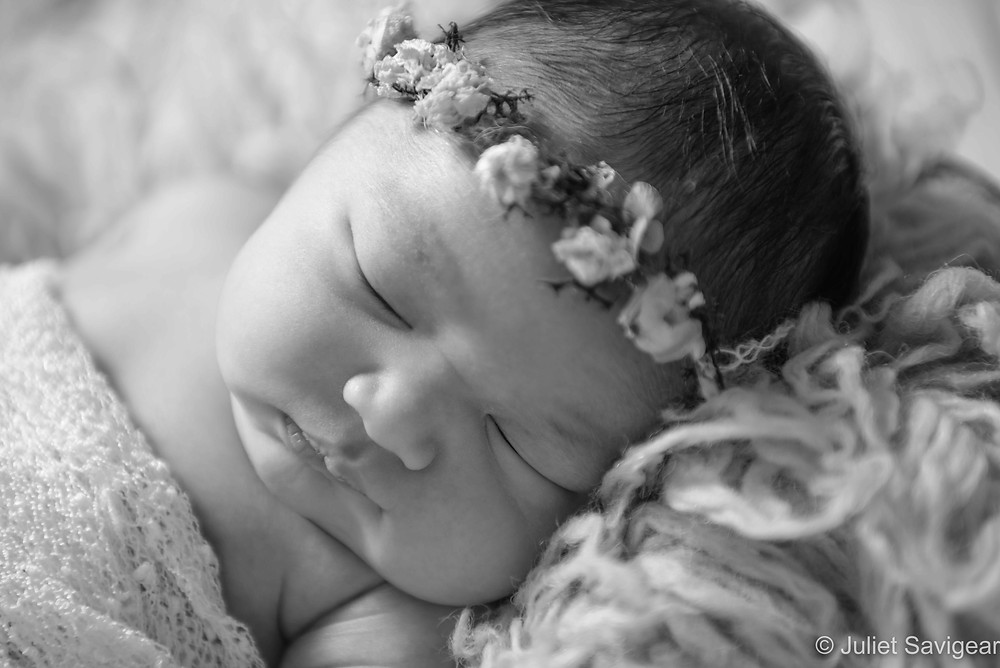 Baby with rosebud headband