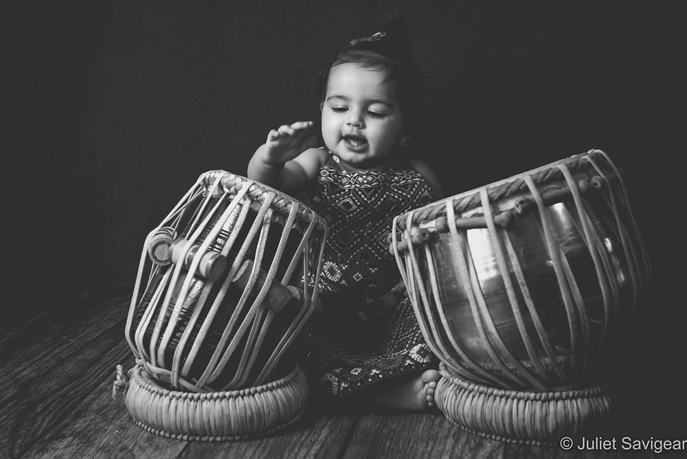 Baby with Indian dhol drums