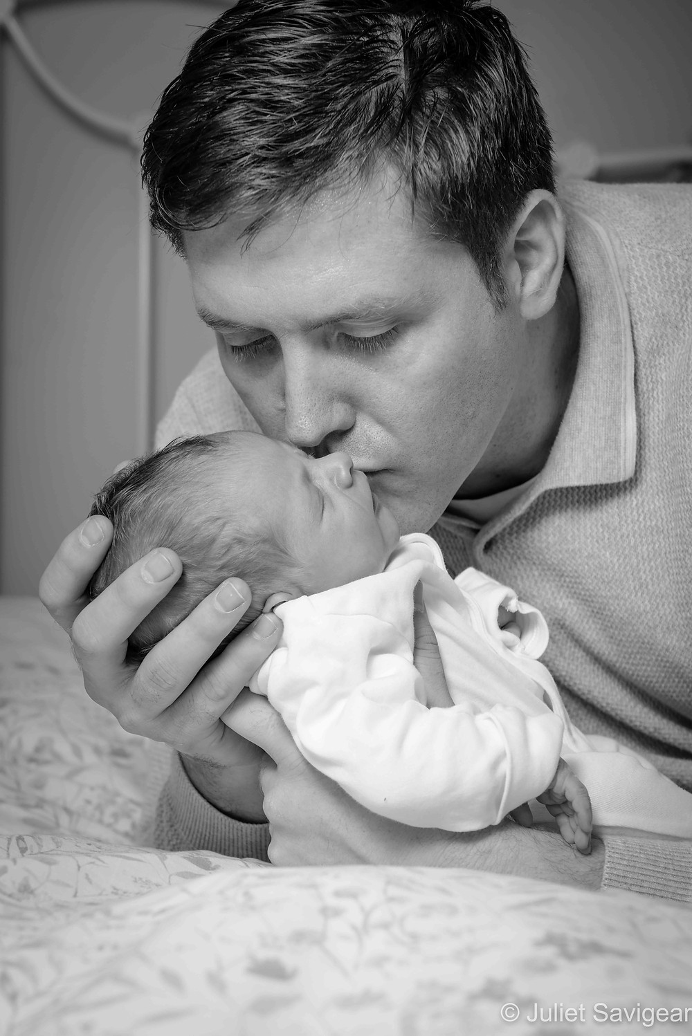 Daddy kissing baby boy