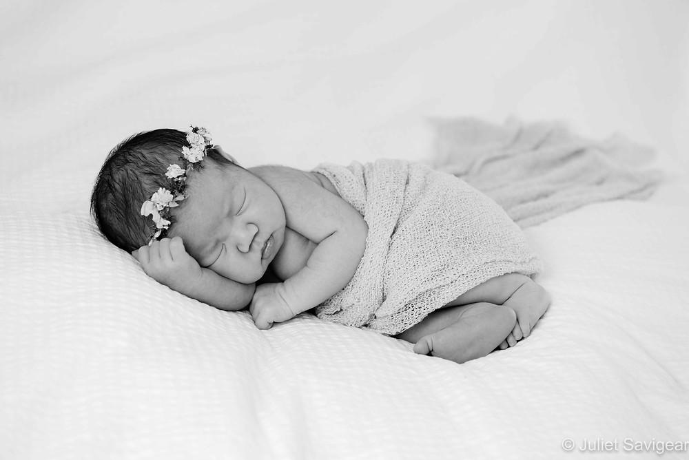 Sleeping baby girl with flower headband