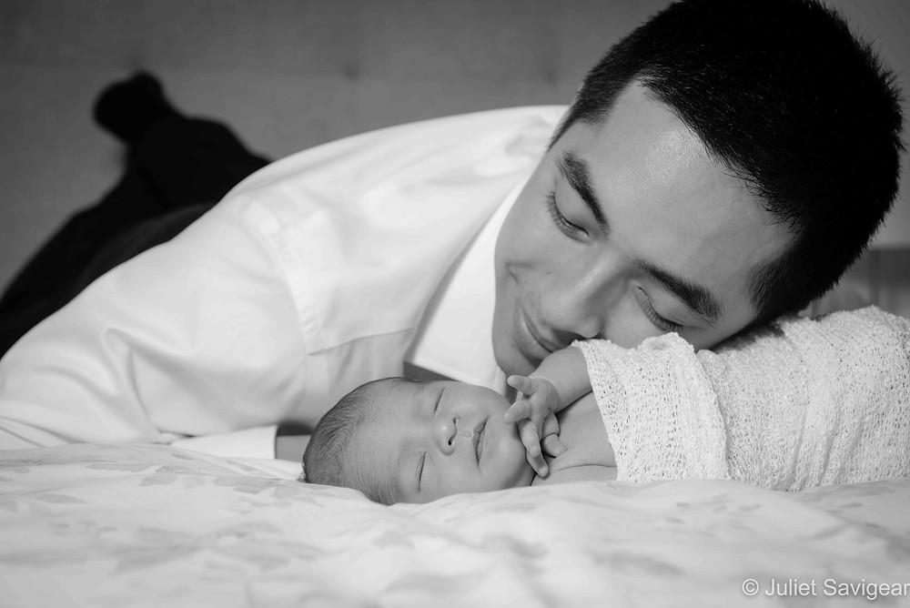 Daddy gazing adoringly at baby