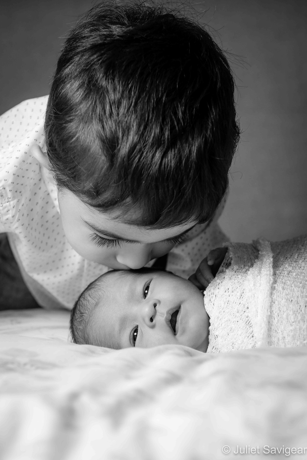 Brother's kiss for baby sister