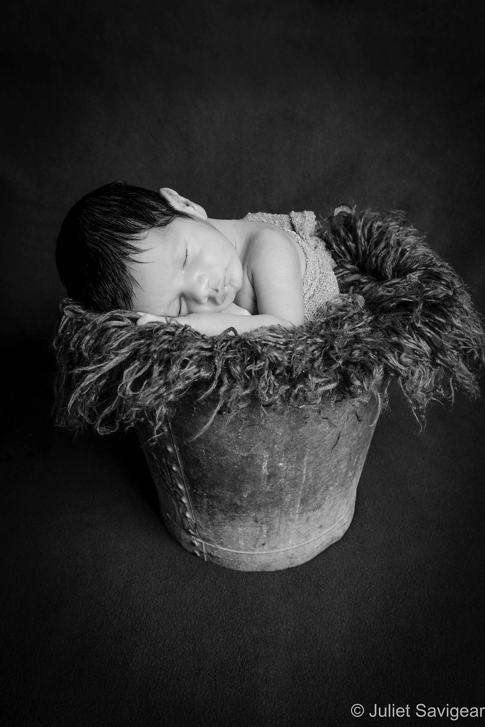 Baby Sleeping In A Bucket