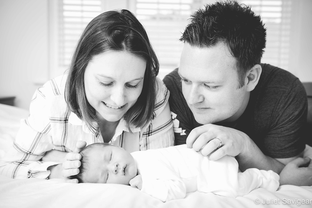 Family portrait at home with newborn baby
