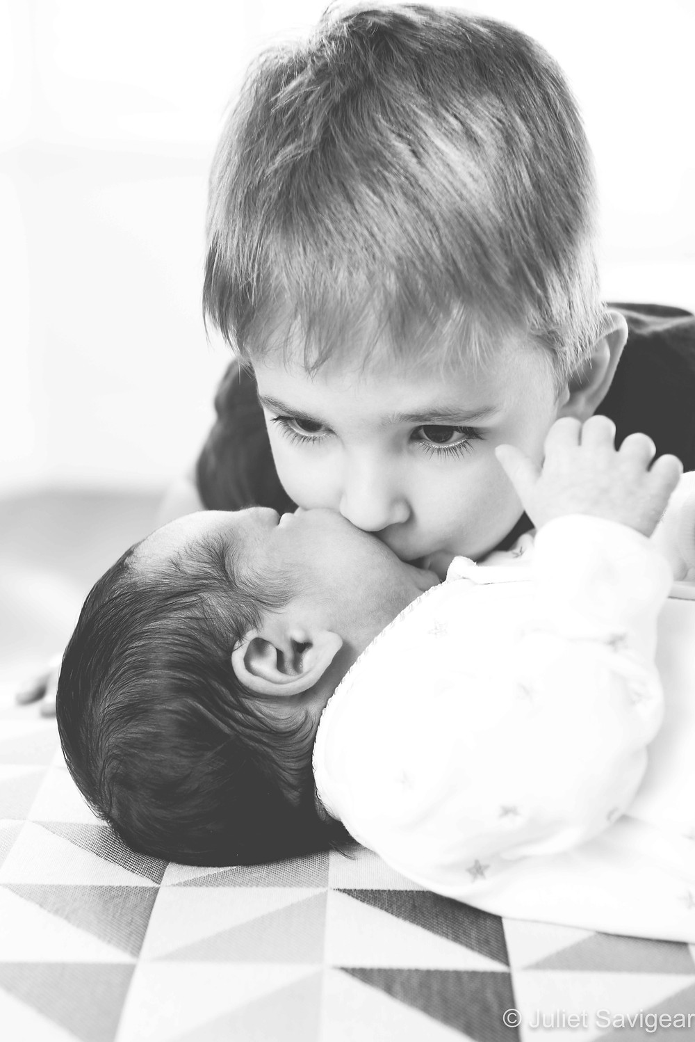 kisses for new baby brother