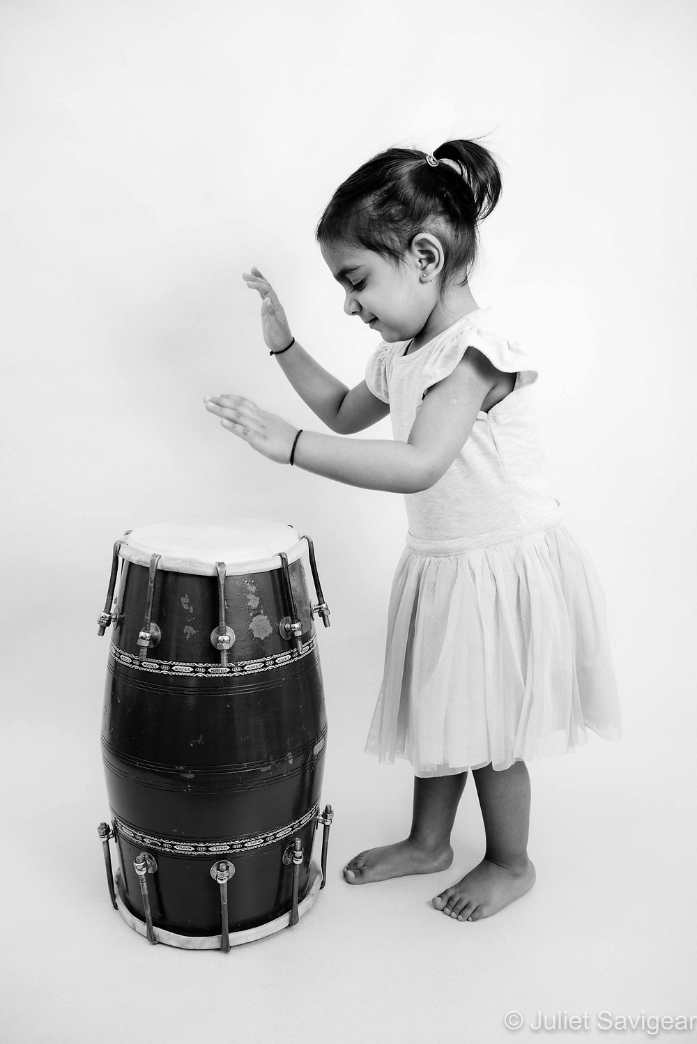 Child playing the dhol