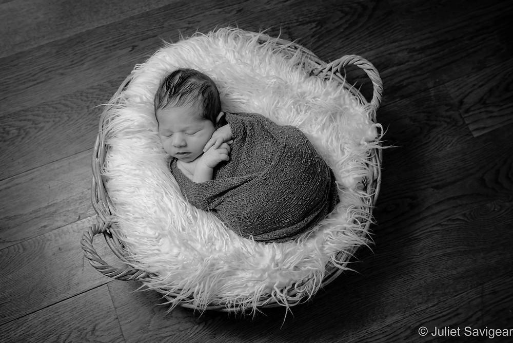 Baby sleeping in basket