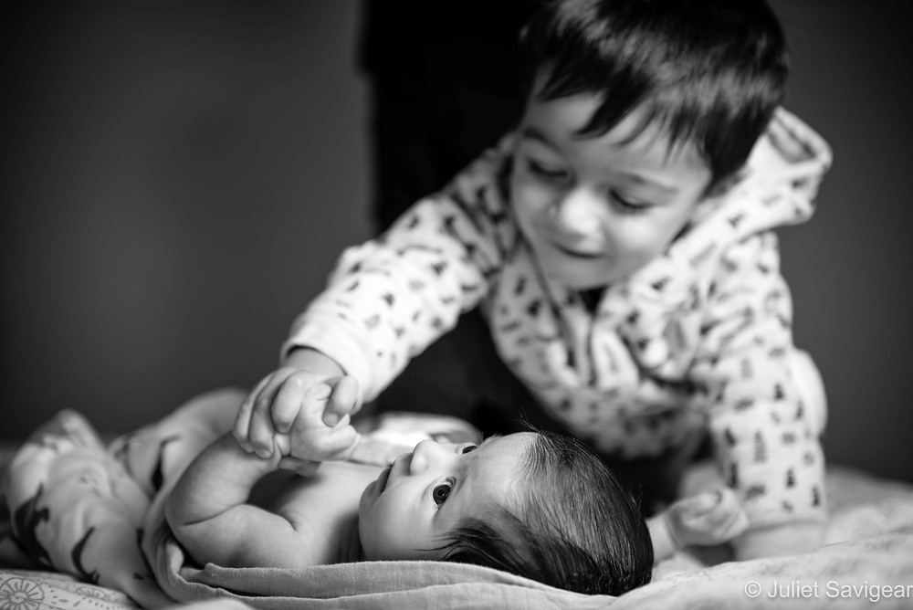 Toddler with baby sister