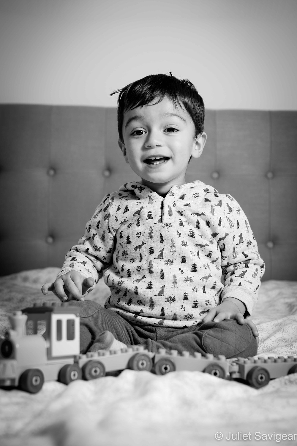 Toddler with toy train