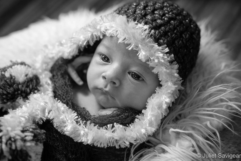 Newborn baby in Christmas bonnet