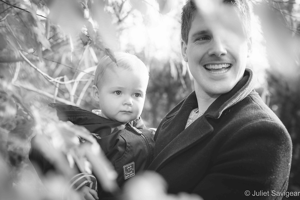 Father and son through the leaves