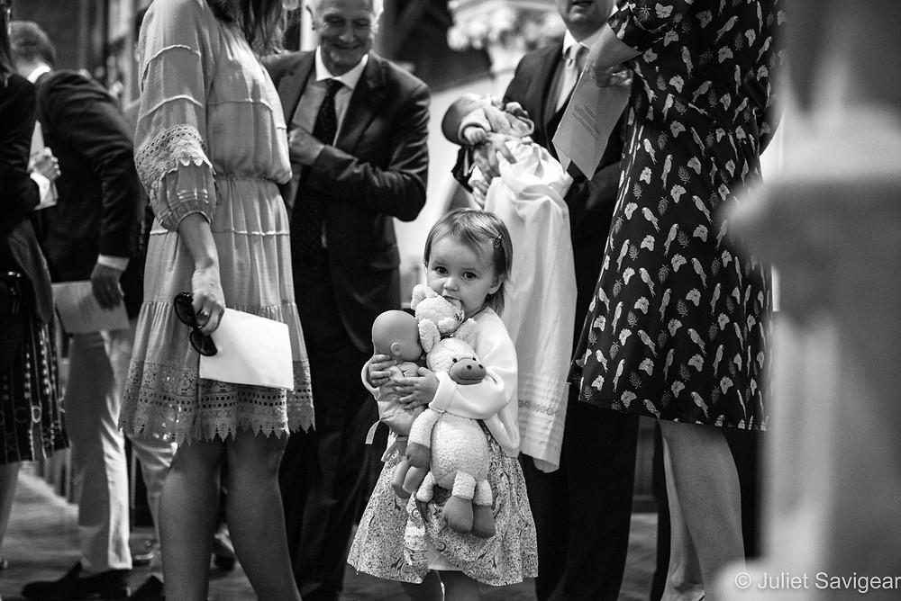 Child holding her toys - christening