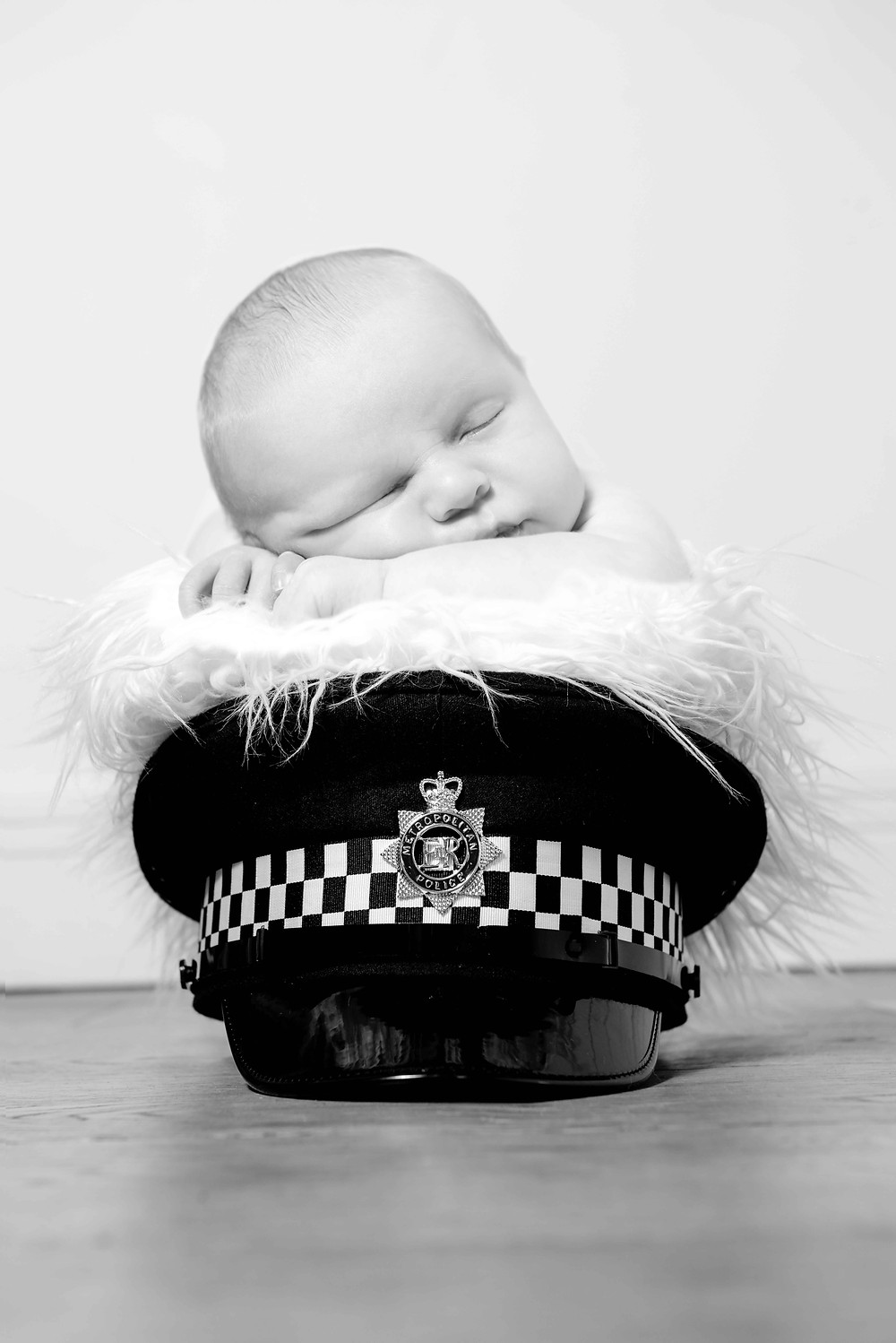Baby in Policeman's hat