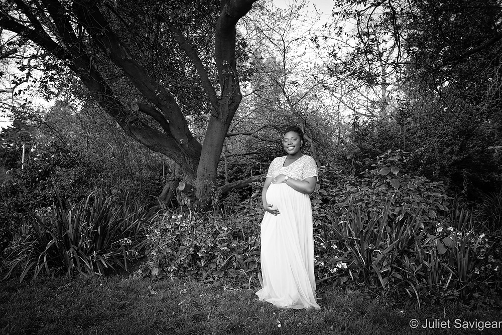 Beautiful maternity photo in the garden