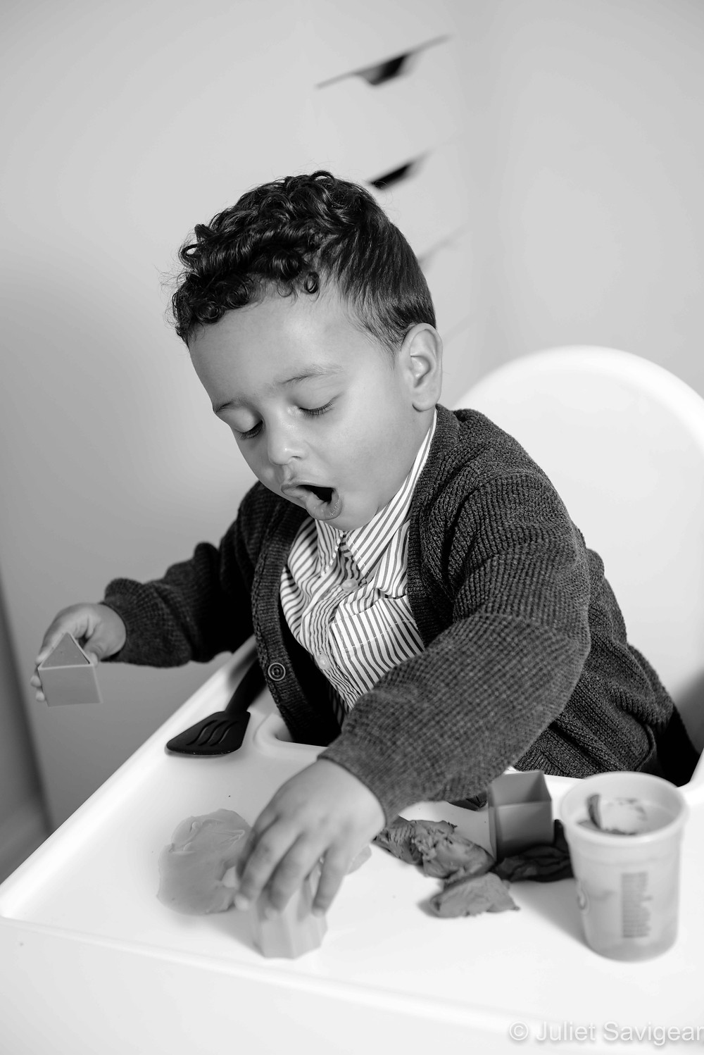 Boy playing with play doh