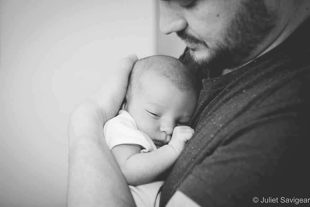 Father cuddling baby