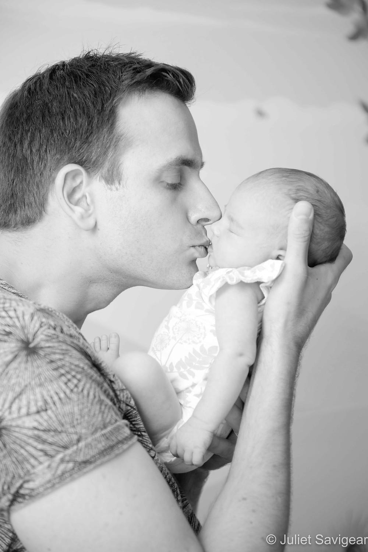 Daddy kissing his bay girl