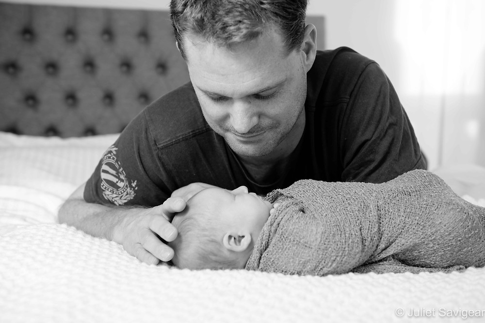 Daddy with newborn baby