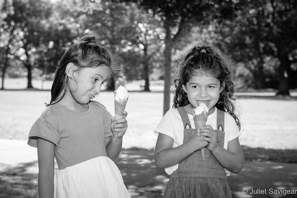 Twins enjoying ice creams