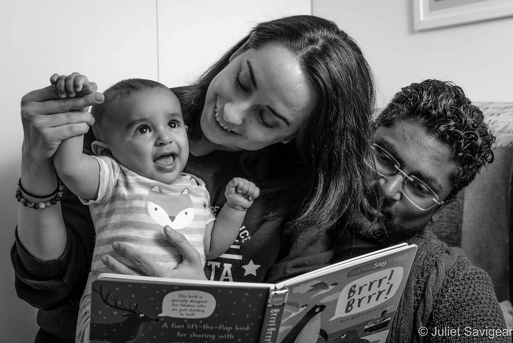 Family reading with baby