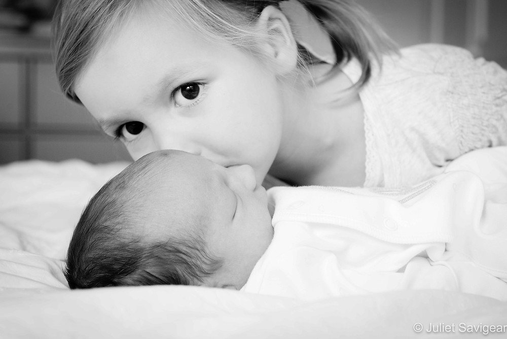 Big sister's kiss for baby