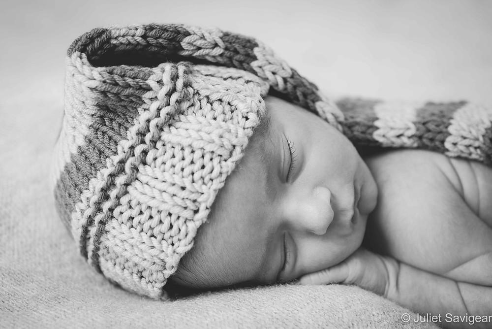 Newborn baby in woolen hat