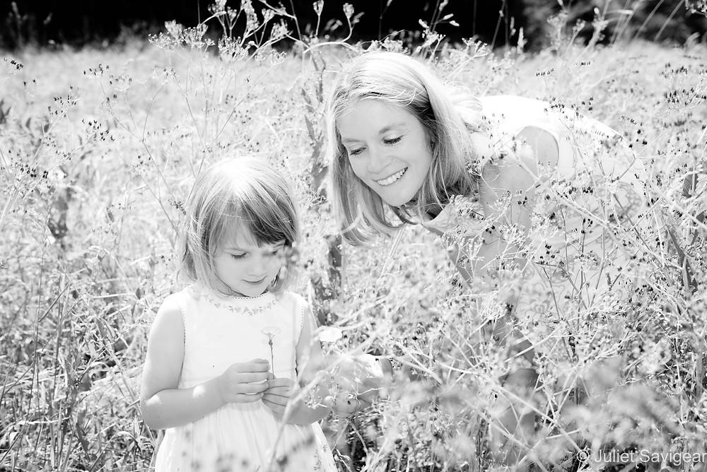 Mother & daughter in the summer grasses