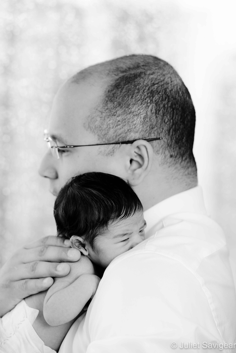 Baby Snuggling On Daddy's Shoulder