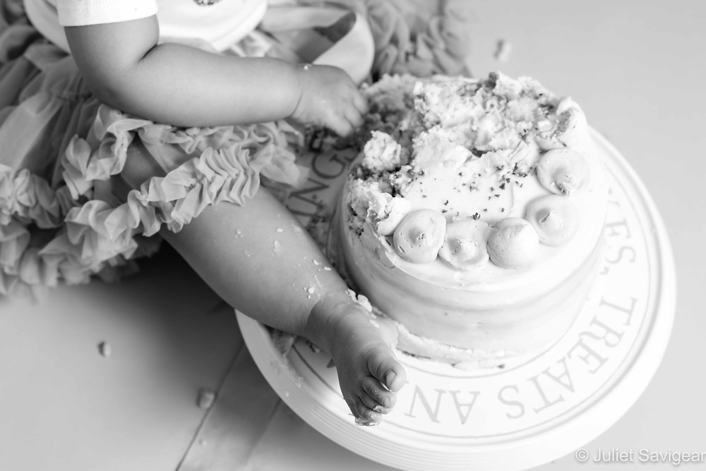 Baby's foot on cake stand
