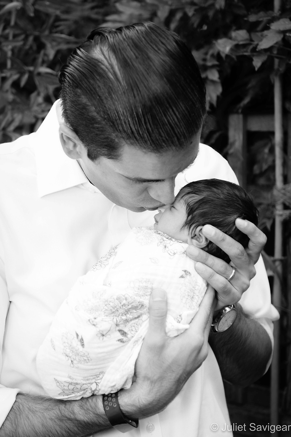 Daddy with baby girl in the garden